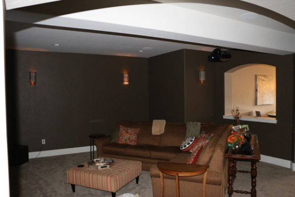 Video projection and wall lighting provide theater atmosphere in the comfort of their own home.