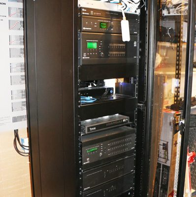 The rack contains, controllers, amplifiers, network routers, tv control boxes, switching and more.